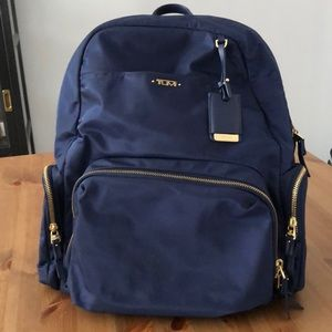 Navy and gold Tumi nylon backpack
